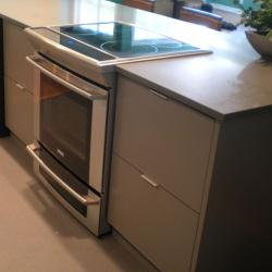 grey all aluminum cabinets with slide-in stove Victoria BC