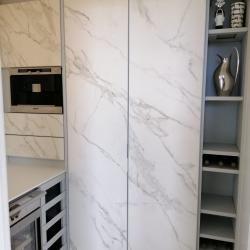Aluminum pantry cabinets in grey and including doors in Neolith