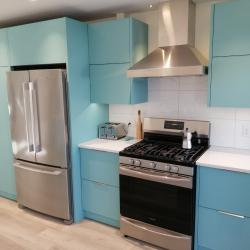 Aluminum kitchen cabinets including pantry in Robin's Egg Blue