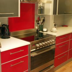 Bright red aluminium kitchen with dark grey and silver accents