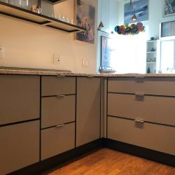 Aluminum kitchen cabinets in two-tone brown and beige and including smart corner pull-out