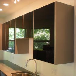 Aluminum cabinetry high-gloss black upper cabinets Oak Bay Victoria