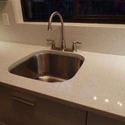 bone white aluminium galley kitchen white quartz with undermount sink