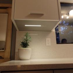 bone white aluminium galley kitchen under cabinet LED lighting