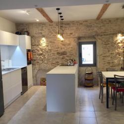 white textured aluminum non-toxic kitchen cabinets stone wall Languedoc Rousillon Pezenas