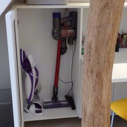 custom desk under stairs in white aluminum extra storage for vacuum  design by IMDesign
