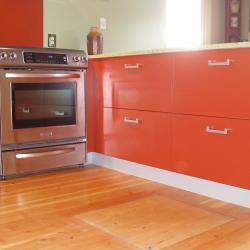 brick red, glass uppers, recycled glass countertop olive colour, red backsplash